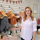 Rochelle Simmons, owner of Sawyer + Sunny Boutique, shows off some of the products on offer at the new downtown Sydney shop that is dedicated to mothers and babies. The new store is located on Charlotte Street.