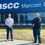 Michael Keating, left, and the principal of NSCC Marconi Campus Fred Tilley, stand outside the Nova Scotia Community College (NSCC) location on March 31.